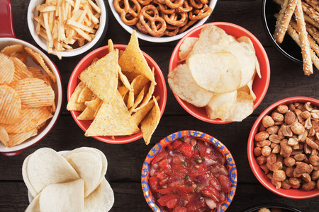 tortilla chips: Tortilla chips and other salty snacks with homemade salsa Stock Photo