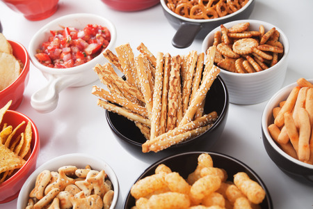 sesame cracker: Salty grissini sticks with sesame seed and other savory snack Stock Photo