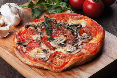 puff pastry: Puff pastry pizza or pie with musrooms, tomato and cheese