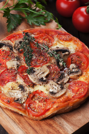 puff pastry: Puff pastry pizza or pie with mushrooms, tomato and cheese Stock Photo