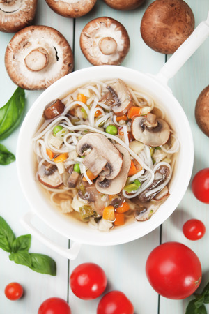 vegetable soup: Clear portabello mushroom soup with noodle and vegetable Stock Photo