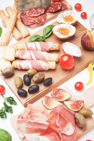 processed food: Prosciutto di Parma with olives and other italian antipasto food
