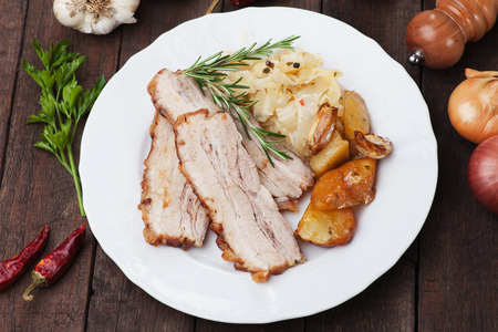 pork: Roasted bacon or pork belly with potato and sauerkraut Stock Photo