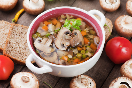button mushroom: Clear portabello mushroom, vegetable and noodle soup