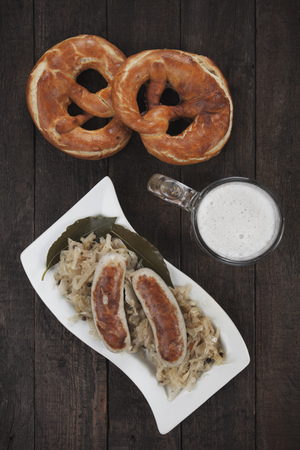 weisswurst: German white sausages with sauerkraut, pretzel and beer