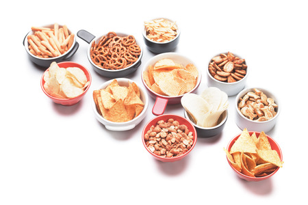 salty: Salty crackers, tortilla chips and other savory snacks isolated on white background