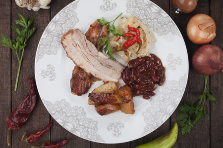 kidney beans: Roasted bacon or pork belly with sauerkraut, kidney beans and baked potato