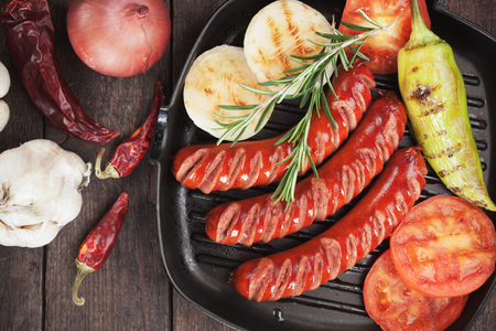 grilled vegetables: Grilled sausages and vegetables in grilling pan Stock Photo