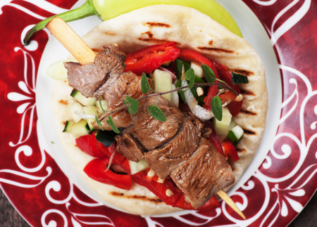 pita bread: Souvlaki or kebab, grilled meat skewer served with pita bread Stock Photo