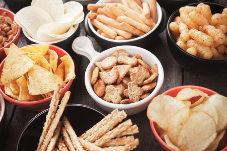 snack: Salty crackers, tortilla chips and other savoury snacks with salsa dip