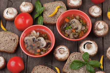 vegetarian cuisine: Clear portabello mushroom and vegetable soup served in a bowl