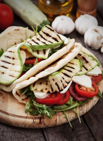 sandwish: Piadina romagnola, italian flatbread sandwish with zucchini and mozzarella cheese