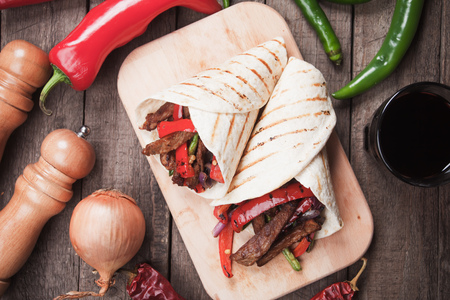 fajita: Mexican fajitas, spicy beef and vegetable in tortilla wrap Stock Photo