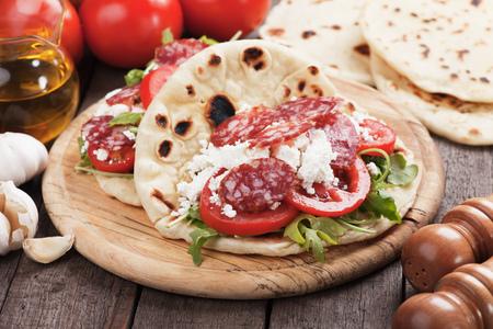 ricotta cheese: Piadina Romagnola, Italian Flatbread Sandwich with Pepperoni, ricotta cheese, tomato and rocket salad