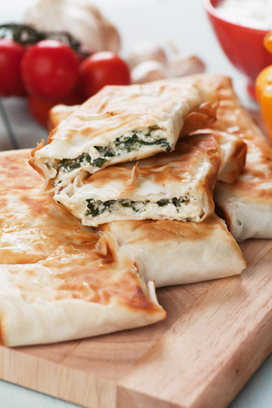 filo: Borek or pita, filo pastry with cheese and chard or spinach filling Stock Photo