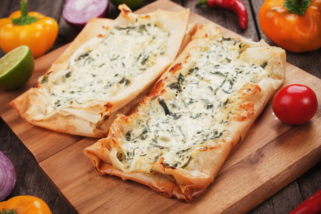 fast meal: Phyllo pastry filled with cheese and spinach, traditional balkans fast food meal Stock Photo