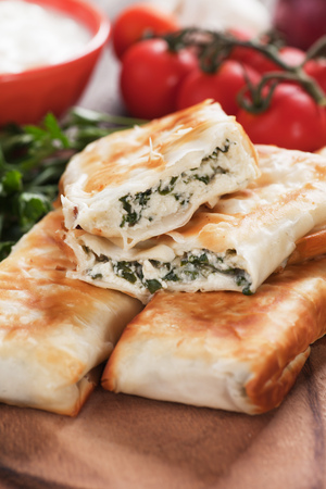 filo pastry: Borek or pita, filo pastry with cheese and spinach filling Stock Photo