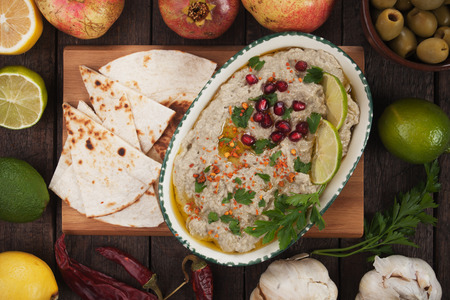 pita bread: Baba ghanoush, levantine eggplant dip served with   pita bread, lime slices and pomegranate Stock Photo