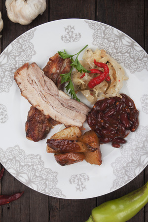 kidney beans: Roasted bacon or pork belly with sauerkraut, kidney beans and potato