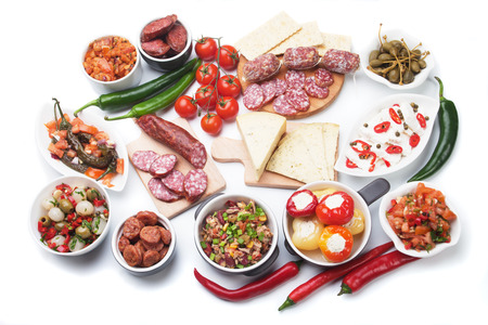 antipasto: Tapas, antipasto or meze, traditional mediterranean cold buffet food isolated on white background Stock Photo