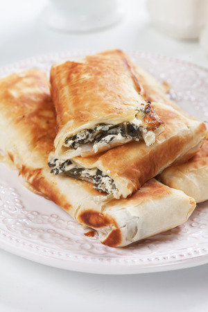 pastries: Borek or pita, filo pastry with cheese and chard or spinach filling Stock Photo