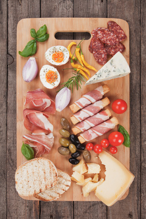 antipasto: Prosciutto di Parma with olives and other italian antipasto food