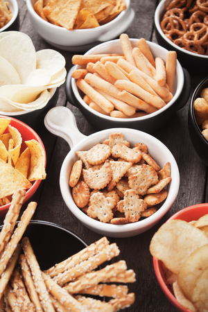 tortilla chips: Salty crackers, tortilla chips and other savoury snacks with salsa dip