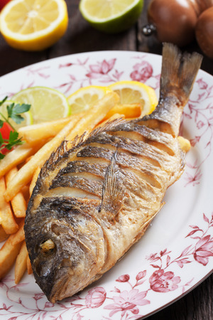 daurade: Fried bream fish with french fries and lemon