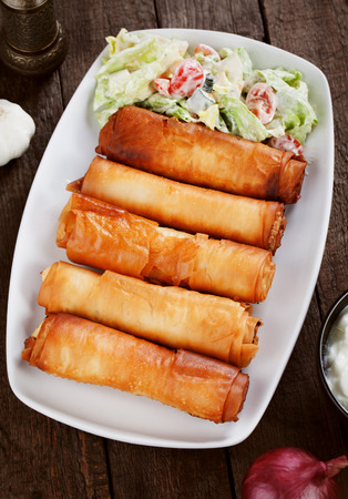 balkans: Pita sirnica, balkans phyllo pastro rolls filled with cheese Stock Photo