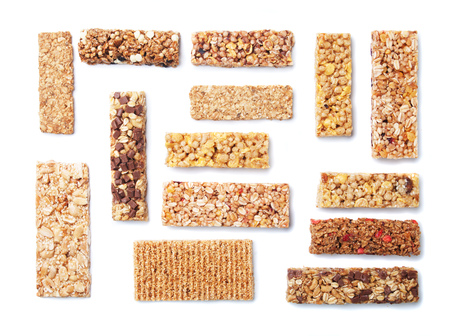white bars: Granola bars with cereals and dried fruit isolated on white background