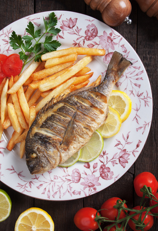 daurade: Grilled bream fish with french fries and lemon