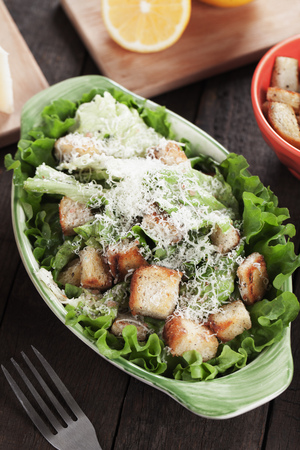 caesar salad: Classic caesar salad with roman lettuce, croutons, parmesan cheese and dressing Stock Photo