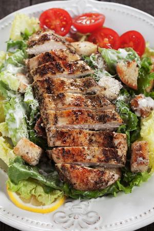 caesar salad: Grilled chicken steak served over caesar salad
