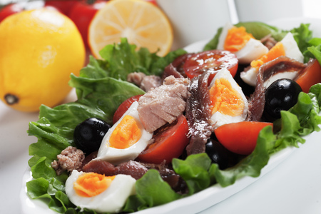Salad Nicoise with tuna, anchovy, boled eggs, olives and lettuce Stock Photo