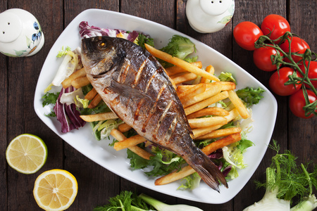 freshwater fish: Grilled bream fish with french fries and salad