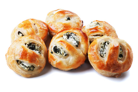 party pastries: Puff pastry filled with spinach and cheese isolated on white background Stock Photo