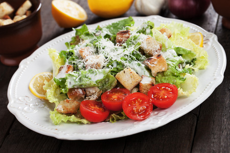 caesar salad: Caesar salad with roman lettuce, croutons, parmesan cheese and dressing