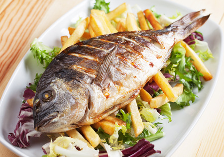daurade: Grilled bream fish with french fries and salad