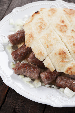 minced meat: Cevapcici, bosnian minced meat kebab with onion and somun bread
