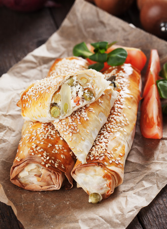 sesame street: Baked phyllo pastry rolls filled with cheese and vegetables