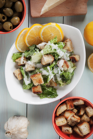 caesar salad: Classic caesar salad with lettuce, croutons, parmesan cheese and dressing