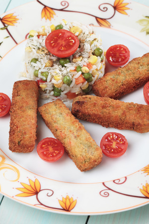 cooked rice: Breaded veggie sticks served with cooked rice Stock Photo