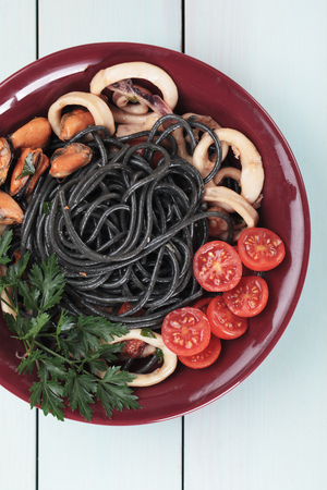 mussel: Black spaghetti pasta with squid rings and mussels