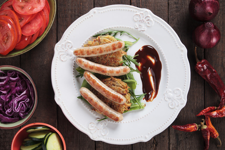 browns: Grilled sausage with hash browns, rocket salad and barbecue sauce