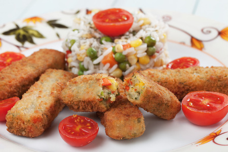 cooked rice: Breaded veggie sticks or croquettes with cooked rice Stock Photo