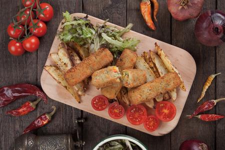 breaded: Breaded veggie sticks with roasted potato vedges Stock Photo