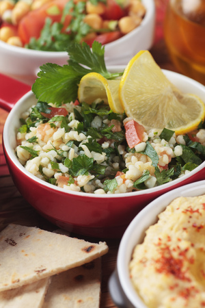 Tabbouleh, middle eastern salad with bulgur wheat pasta, tomato and parsley Stock Photo