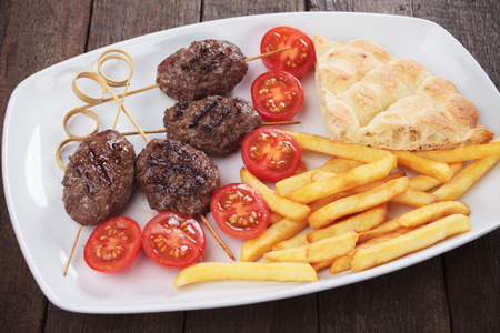kabab: Kofta kebab, turkish minced meat skewer with pita bread and french fries