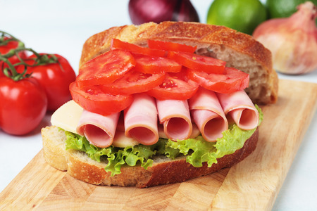 bologna baloney: Baloney or Bologna sausage sandwich with tomato and lettuce Stock Photo
