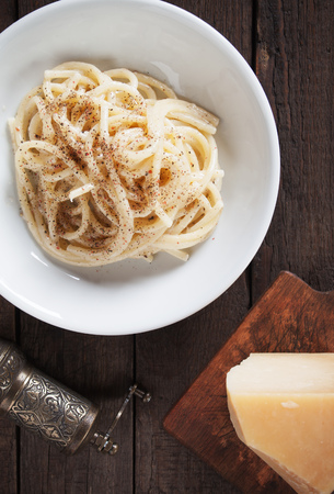 Cacio e pepe, italian spaghetti or vermicelli pasta with cheese and pepper